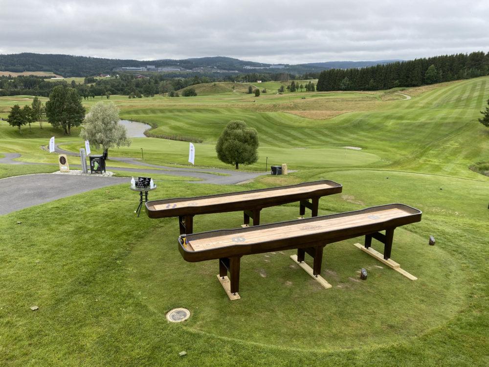 Golf club shuffleboard